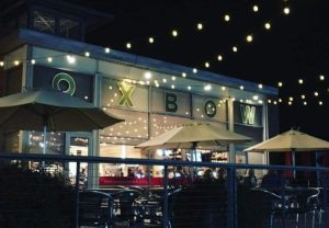 Exterior photo of the Oxbow Market at night