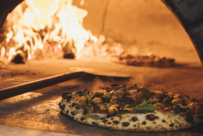 Baking a pizza in our wood-burning oven